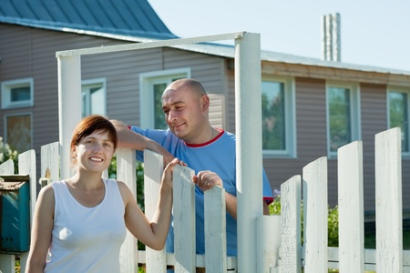 Young woman and man near fence wicket Stock Photo - 10643135