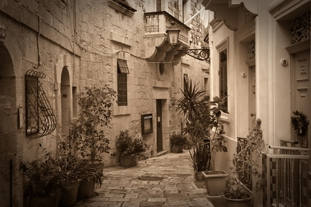 replica: Retro photo of old picturesque street of Valletta. Malta