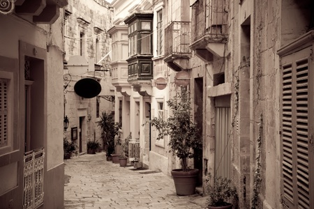 olden: Retro photo of ctreet in old European town (Mdina, Malta) Stock Photo