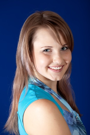 casualy: Portrait of beauty girl over blue background