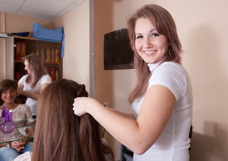 Female hairdresser working with long-haired girl Stock Photo - 10677679