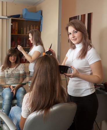 Hairdresser dye his hair long-haired girl photo