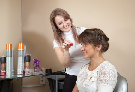 hairtician: Female hair stylist working with long-haired girl. Focus on customer Stock Photo
