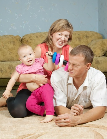 Happy parents with baby in home interior Stock Photo - 10677804