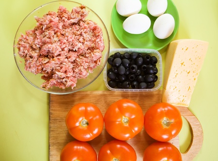 farcie: ingredients for stuffed tomato on cook-table. See in series stages of cooking of stuffed tomato  Stock Photo