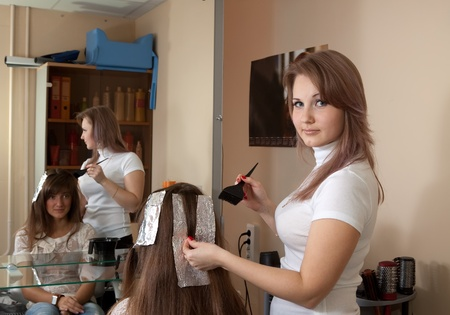 hair stylist coloring   long-haired girl hair  photo