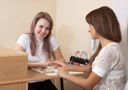 manicurist: manicurist working with  woman nails