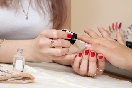 manicurist working with  woman nails photo