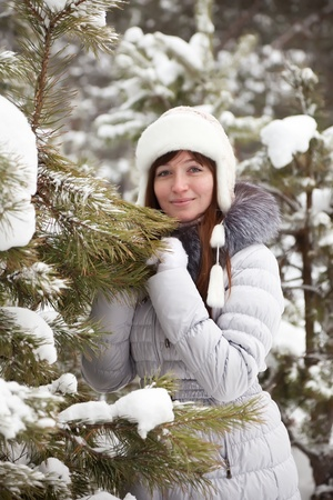 Outdoor winter portrait of woman in wintry clothes photo