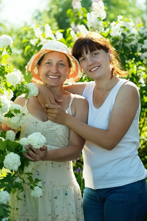 guelder rose: Two women in Roseum plant at garden