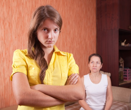 Mature mother and teenager daughter after quarrel at home