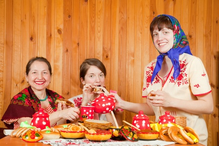 banket: Women drinks tea with pancake during  Pancake Week