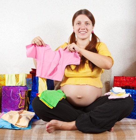pregnant woman with purchases  on sofa at home Stock Photo - 10741904