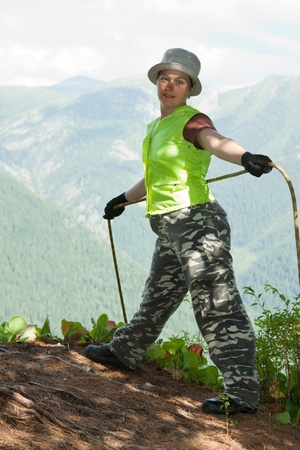 belay:  Climber belay partner on top forest mountains Stock Photo