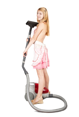 Sexy girl with vacuum cleaner over white