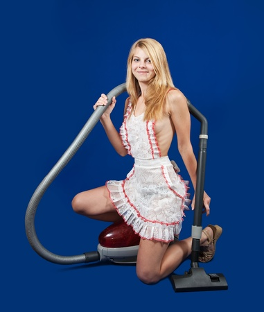 Sexy maid with vacuum cleaner over blue Stock Photo - 10769851