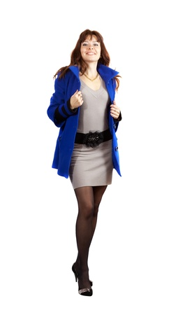full length shot of woman in blue coat on white background photo