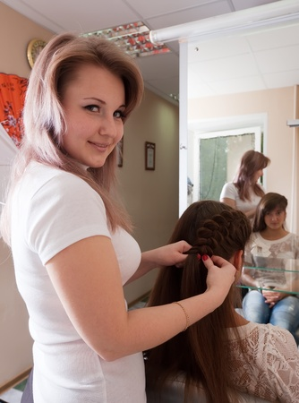 Female hairdresser working with long-haired girl Stock Photo - 10812557