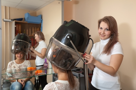 Female hairdresser working with hair dryer Stock Photo - 20544655