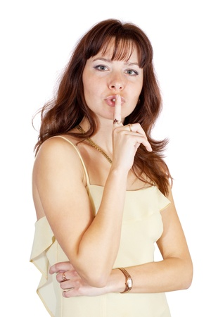 Beautiful woman making silence sign. Isolated over white. Stock Photo - 10812699