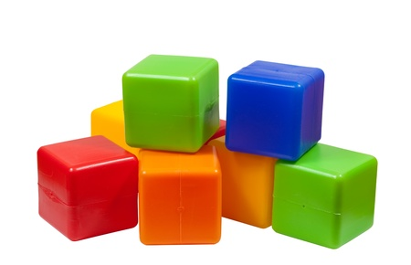 few:  Few plastic toy blocks on white background Stock Photo