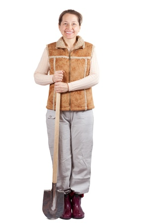 welly: full length shot of happy mature woman with spade over white