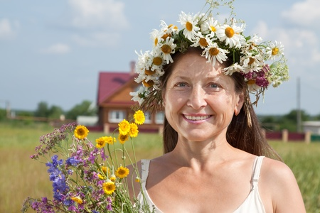 chaplet: Outdoor portrait of   woman in  camomile chaplet Stock Photo