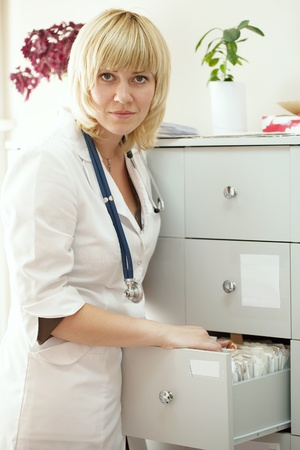 medical intern searching for patient's records in clinic Stock Photo - 10885449