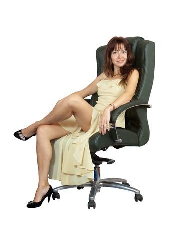 elbow chair: Sexy woman sitting on luxury office armchair, isolated over white background Stock Photo