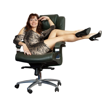 ergonomic: Sexy woman sitting on luxury office armchair, isolated over white background Stock Photo