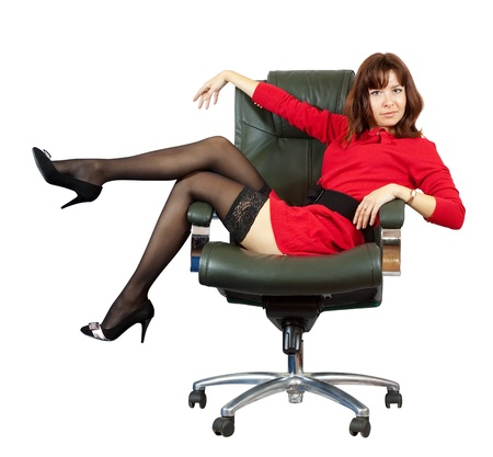 Sexy woman sitting on luxury office armchair, isolated over white background Stock Photo - 10885607