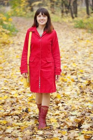 Full length shot of girl  in autumn park Stock Photo - 10885918