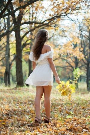 Full length shot of girl  in autumn park Stock Photo - 10929743