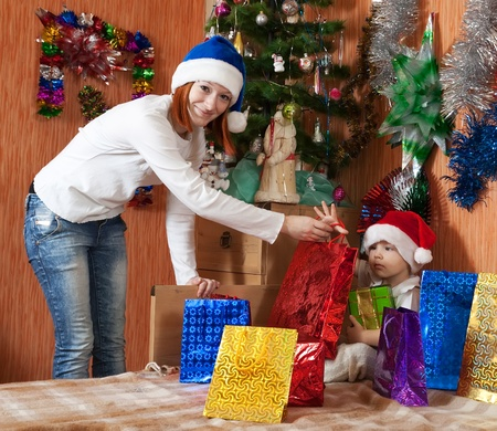 Mother and little son with  Christmas gifts  at home Stock Photo - 10929733