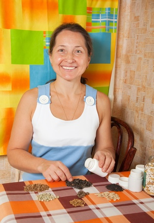 seeds of various: Mature woman with  various seeds at home Stock Photo
