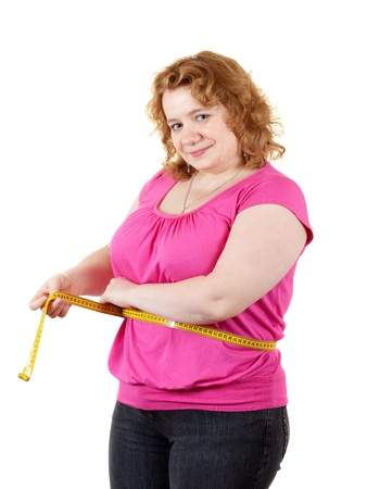 overweight: Overweight woman measuring waist. Isolated over white background