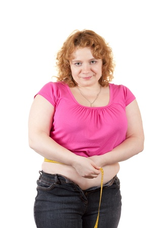 Overweight woman measuring waist with tape measure. Isolated over white background