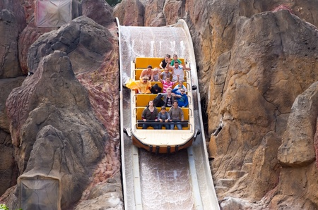port aventura: SALOU, SPAIN - APRIL 13: People riding in Theme Park in April 13, 2011 in Salou, Spain. Tutuki Splash is one of most exhilarating rides in Polynesia area at Port Aventura