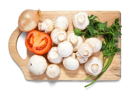 tomatto: champignon mushroom on cutting board over white