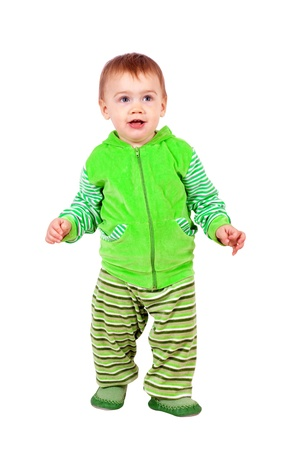 Happy toddler walking over white background photo