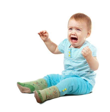 Crying baby of one year old  over white background photo