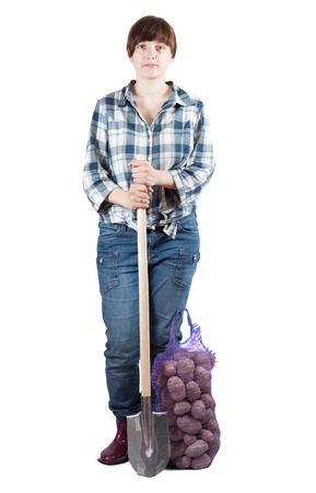 welly: Female farmer  with harvested potatoes and spade over white Stock Photo