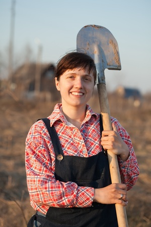 Happy female farmer  with spade  in rural photo