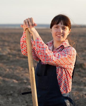 Female farmer  with spade in plowed field Stock Photo - 11132148