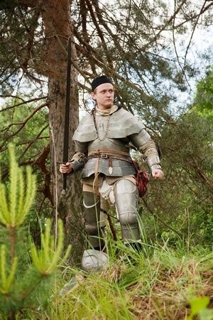 xv century: Knight in armour end of XV century in pine forest