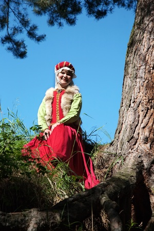 girl in european historical clothing  of XIII century at nature photo
