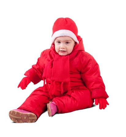 toddler in wintry clothes. Isolated over white background with shadow photo