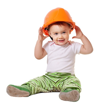 work safety: Toddler in hardhat plays  over white background