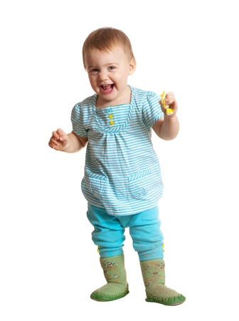 toddler walking: Happy toddler standing over white background Stock Photo