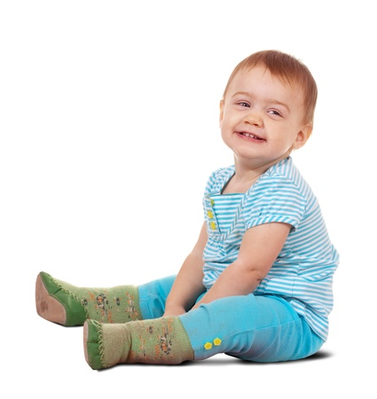 Sitting happy toddler. Isolated over white background with shadow photo